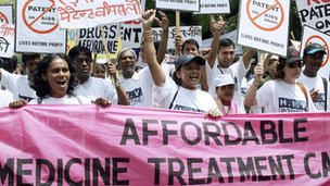 HIV/AIDS patients and members of Non-Governmental Organizations shout anti-government slogans during a march in New Delhi, 10 May 2006.