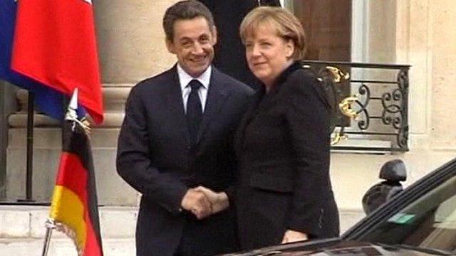 France's Nicolas Sarkozy and Germany's Angela Merkel in Marseilles