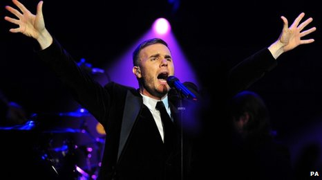 Gary Barlow on stage singing