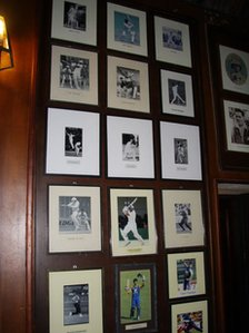 Photos on the wall of a cricket club in Sri Lanka
