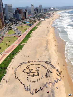 Protesters form an image of a lion on a beach in Durban (Image: AP)
