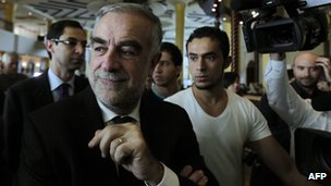 Luis Moreno-Ocampo arrives at a hotel in Tripoli on 22 November 2011.