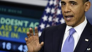President Barack Obama gestures during a news conference in the White House 8 December 2011