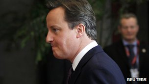 British Prime Minister David Cameron leaves the European Council headquarters in Brussels, 9 December
