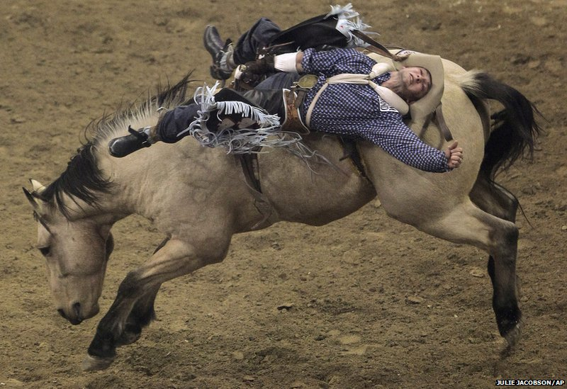 Will Lowe, of Canyon, Texas, rides in the bareback competition
