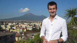 Reporter Ben Thompson in Pompeii. Mount Vesuvius is in the background