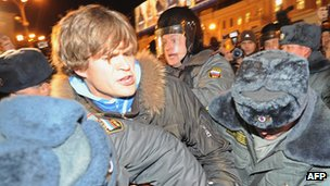 Russian police detain a opposition activist at a protest in Triumfalnaya [Triumphal] Square