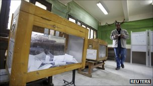 Ballot box and male voter in run-off elections