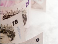 Ten and five pound notes