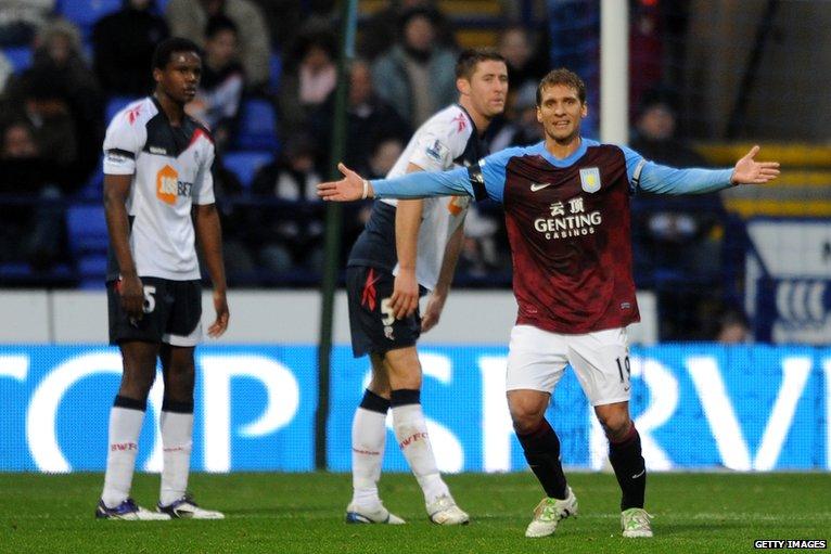 Aston Villa's Stiliyan Petrov scores