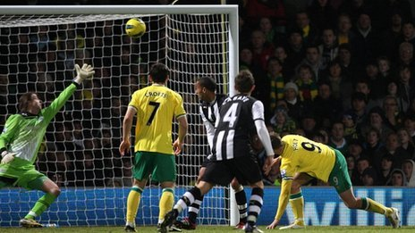 Norwich striker Grant Holt scores the fourth