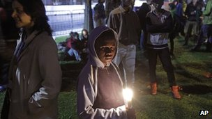 Protesters hold a night vigil as talks at the climate change summit in Durban, South Africa, on 9 December 2011.
