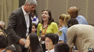 US protester Abigail Borah disrupts negotiator Todd Stern in Durban, South Africa on 8 December 2011