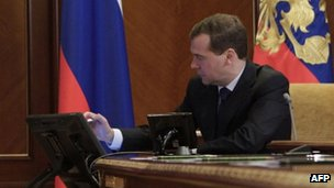 Russian President Dmitry Medvedev consults a computer at his Gorki residence outside Moscow, 23 November