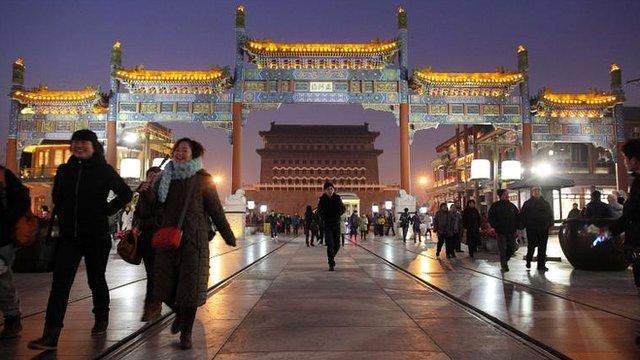 Shoppers in Beijing on December 10, 2011
