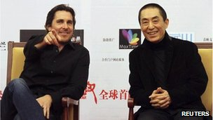 British actor Christian Bale (L) and Chinese director Zhang Yimou attend the premiere of &quot;The Flowers of War&quot; in Beijing December 11, 2011