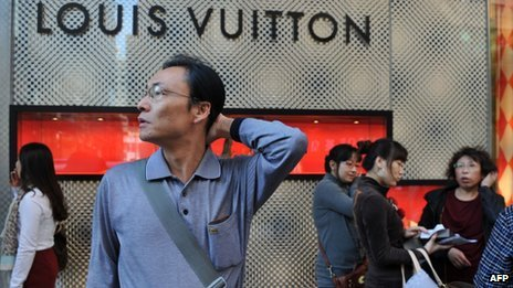 Chinese tourists outside a Louis Vuitton store in Hong Kong
