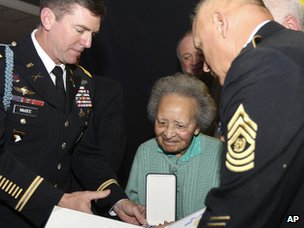 Augusta Chiwy, centre, receives an award for valour from the US army in Brussels on 12 December 2011