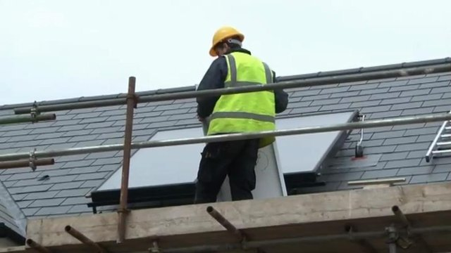 Solar panels being fixed on roof
