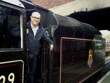 Adam Shaw on a train