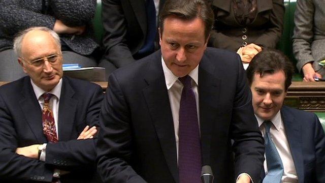David Cameron (centre)