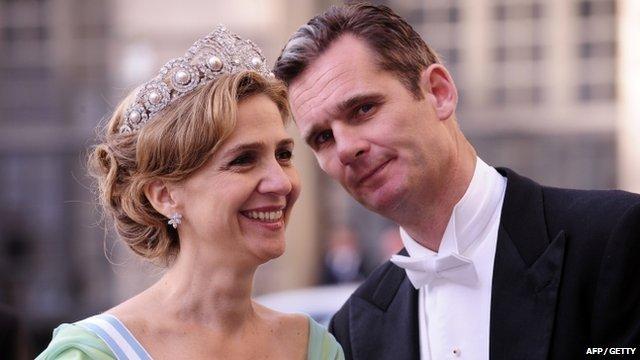 Spain's Princess Cristina of Spain (L) and her husband Inaki Urdangarin (R)