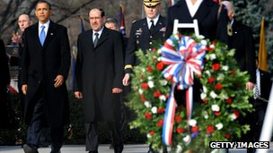 US President Barack Obama (L) and Iraqi Prime Minister Nouri Maliki (2L) at Arlington National Cemetery on 12 December 2011