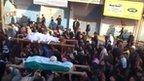 Video posted online purportedly showing funeral in Maaret Masreen (13 December 2011)