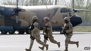 US soldiers run during their military exercises at the airfield of the US airbase in Kyrgyzstan at Manas airport, some 30km outside Bishkek, 14 April 2007.