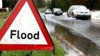 Flood sign on flooded road