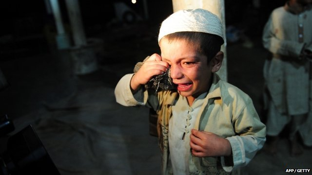 A young student cries after being rescued