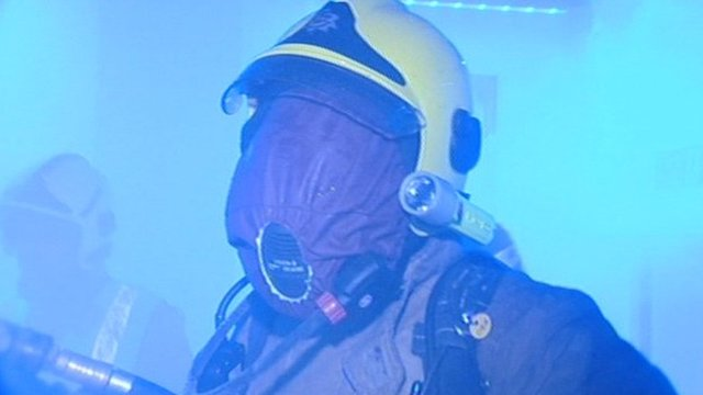 Firefighter wearing blackout mask