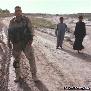 Marine stands in Iraq field