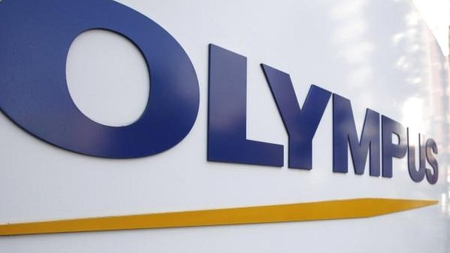 A sign of Olympus Corp outside the company's showroom in Tokyo