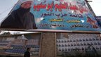 Man walks past the poster for a Salafist al-Nour candidate in Giza (12 December 2011)