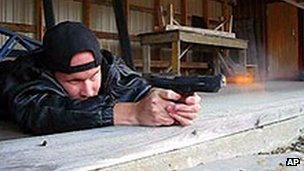 Matti Juhani Saari fires a pistol in a photo posted on his website before the killings