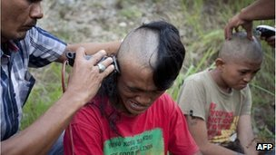 Police shave the hair of detained Indonesian punks at a police school in Aceh Besar in Aceh province