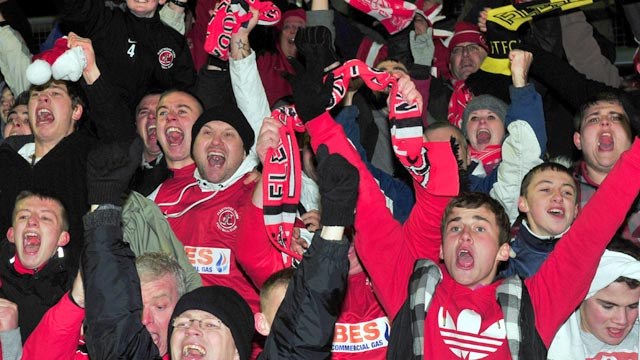 Fleetwood supporters celebrate their win over Yeovil