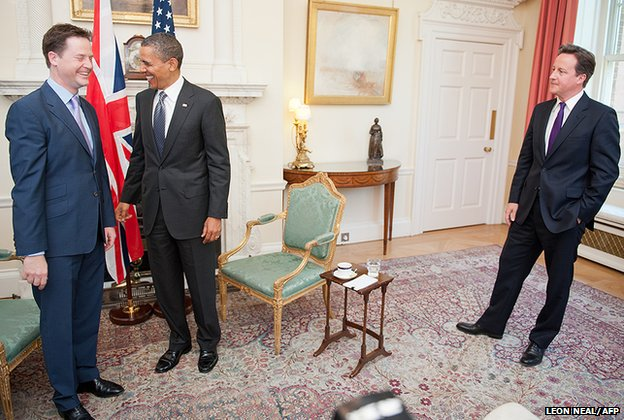 US President Barack Obama (centre) meets Britain's Prime Minister David Cameron (right) and Deputy Prime Minister, Nick Clegg, inside 10 Downing Street