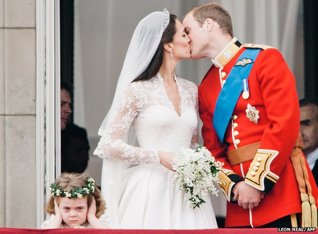 Prince William and his newly titled bride the Duchess of Cambridge kiss on the balcony of Buckingham Palace