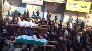 Video posted online purportedly showing funeral in Maaret Masreen (13 December 2011)