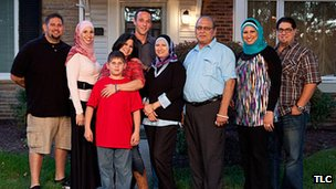 A family from All-American Muslim stands outside of a house