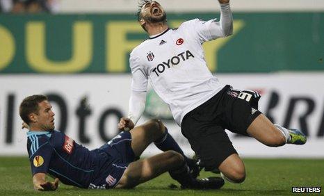 Matthew Upson challenges Hugo Almeida unfairly in the penalty area