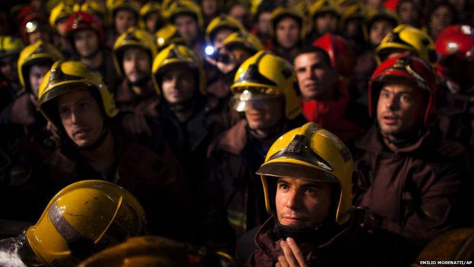 Firefighters take part in protests against spending cuts in Catalonia's public services in Barcelona, Spain