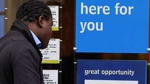 Person looks at vacancies in a window in Liverpool