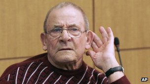 FILE - In this Oct. 28, 2009 file photo Heinrich Boere, a former member of Adolf Hitler's Waffen SS, sits in the dock of a court at the start of his trial in Aachen, Germany. German justice officials said Monday, Dec. 2, 2013 Heinrich Boere, who murdered Dutch civilians as part of a Nazi Waffen SS hit squad during World War II but avoided justice for six decades, has died in a prison hospital. He was 92. (AP Photo/Martin Meissner, File)