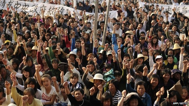 Residents of Wukan attend a rally