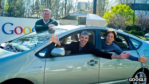 Google&#039;s executive team with one of their self-drive cars