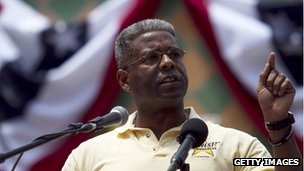 Allen West stands at a rally
