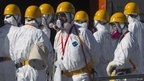 Workers at Fukushima in protective masks and suits